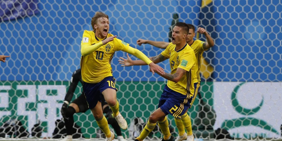 Sweden's Emil Forsberg (L) celebrates with teammates after scoring the winner against Switzerland at the St. Petersburg Stadium