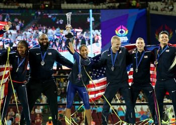 The USA team celebrate their victory in the Athletics World Cup in London, Sunday