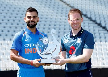 Indian captain Virat Kohli(L) and England skipper Eoin Morgan pose with the ODI trophy, Wednesday
