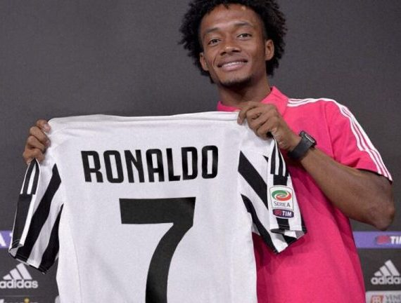 3398c0d73 Juan Cuadrado holds the Juventus No.7 shirt which Cristiano Ronaldo will be  donning at