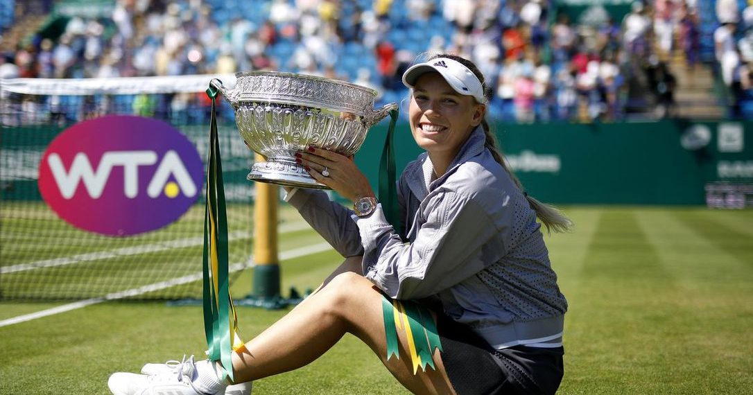 Caroline Wozniacki poses with the winner's trophy at Eastbourne, Saturday