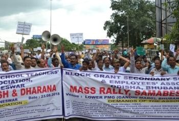 Block grant secondary school teachers and employees take out a rally at PMG Square in Bhubaneswar, Thursday, to press for their various demands including grant-in-aid as per the GIA order-1994.