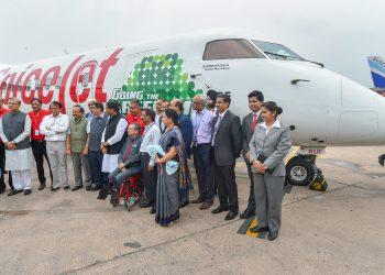 Union Ministers Suresh Prabhu, Nitin Gadkari, Harsh Vardhan, Jayant Sinha, Dharmendra Pradhan and others after the landing of the first flight, running on biofuel, at Delhi Airport terminal on MondayPTI Photo