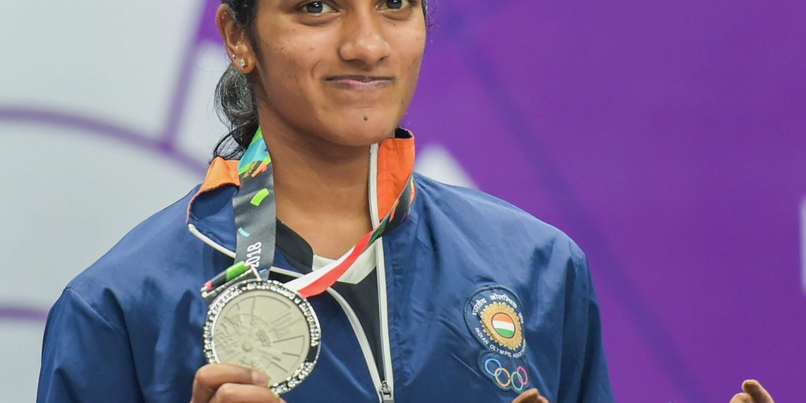 Women's singles badminton silver medalist PV Sindhu poses for a photograph during the medal ceremony of the event at the Asian Games in Jakarta