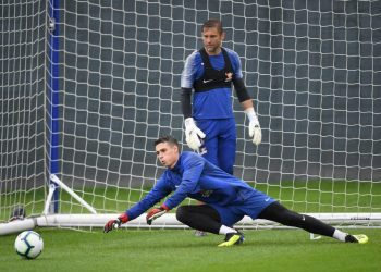 Custodian Kepa Arrizabalaga dives to his right for a save during Chelsea's training session, Thursday