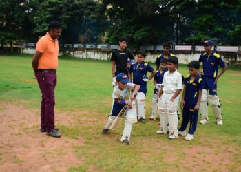 Debashis Mohanty gives pep talk to budding cricketers at Saheed Sporting Ground in Bhubaneswar, Saturday