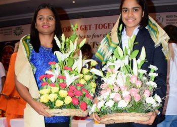 Dutee Chand (L) and Rutuparna Panda pose for a photograph after being felicitated in Bhubaneswar, Sunday