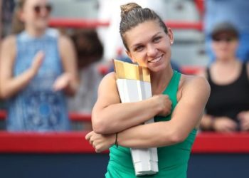 Simona Halep poses with the winner's trophy in Montreal, Sunday