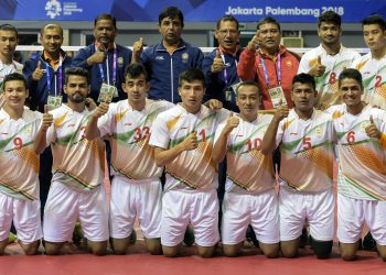 Indian Sepaktakraw team players along with the officials pose for a group photo after winning the first ever Asian Games bronze medal at Jakarta