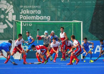 India and Hong Kong China players in action during the men's hockey pool match at the Asian Games in Jakarta