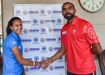 Skipper of the Indian women's hockey team Rani wishes luck to his men's team counterpart before the departure of the teams for the Asian Games in Indonesia