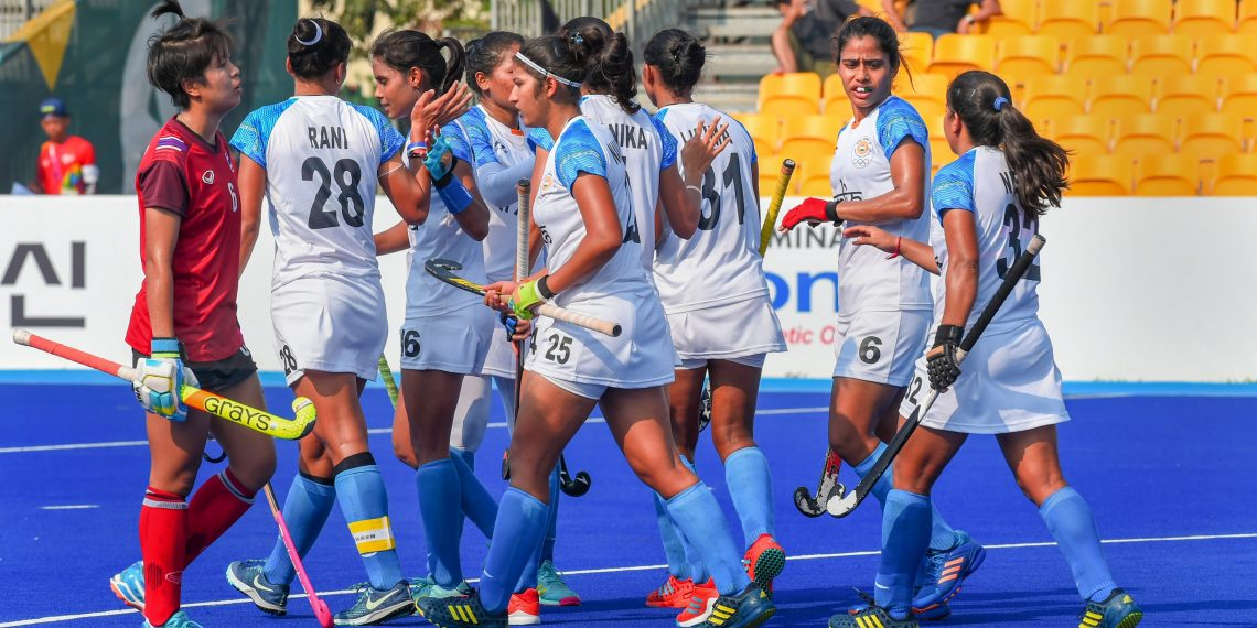 Indian players celebrate after scoring a goal against Thailand during the women's hockey pool match at the Asian Games, Monday