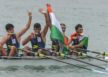 Indian rowing Men's team members Sawarn Singh, Bhokanal Dattu, Om Prakash and S Singh celebrate after the medal ceremony winning the gold medal during the Asian Games