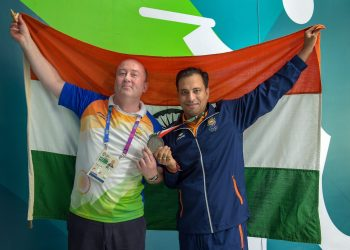 Sanjeev Rajput celebrates with coach Oleg Mikhalov after winning the Silver medal in men's 50m rifle 3 position shooting at the Asian Games