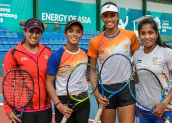 Indian women's tennis team members Ankita Raina, Karman Kaur and Prarthna with their coach Ankita Bhambri (L) pose for a photo after a practice session at Palembang in Indonesia Friday