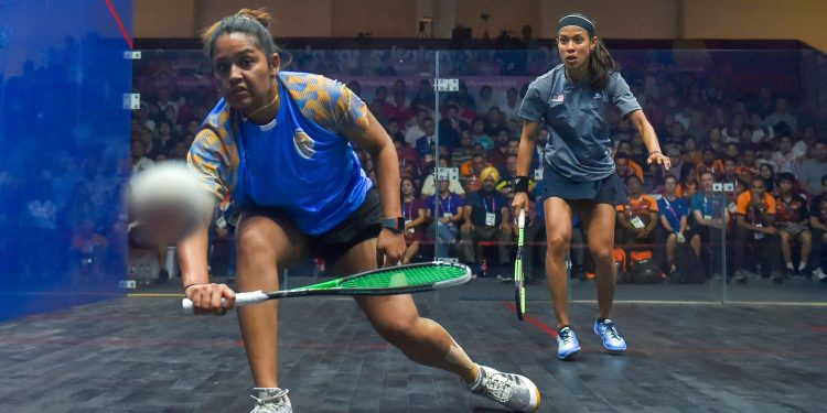 Dipika Pallikal stretches to make a return during her semifinal against Nicol David at Jakarta, Saturday