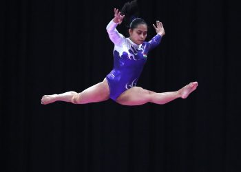 Dipa Karmakar performs on the balance beam during the women's apparatus gymnastics final competition at the Asian Games in Jakarta