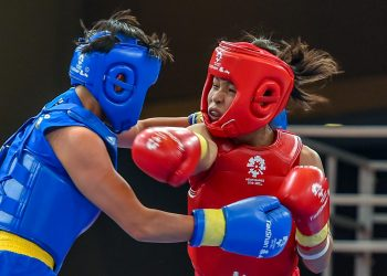 Naorem Roshibina Devi (red) fights China's Cai Yingying at the Asian Games in Jakarta