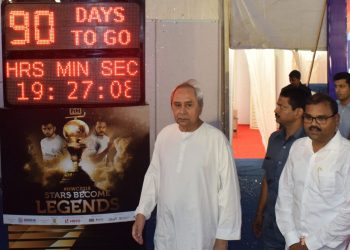 CM Naveen Patnaik unveils the countdown clock for the Men's Hockey World Cup as sports and youth services minister Chandra Sarathi Behera looks on in Bhubaneswar, Wednesday
