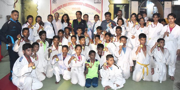Winners of State Open Judo Championships pose with their medals along with guests in Bhubaneswar, Sunday