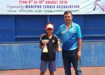 Sohini S Mohanty poses with her trophies along with an official at Manipur, Thursday