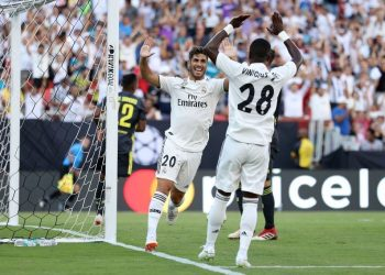 Marco Asensio (20) joins teammate Vinicius Jr for celebration after scoring Real Madrid's second goal against Juventus, Saturday