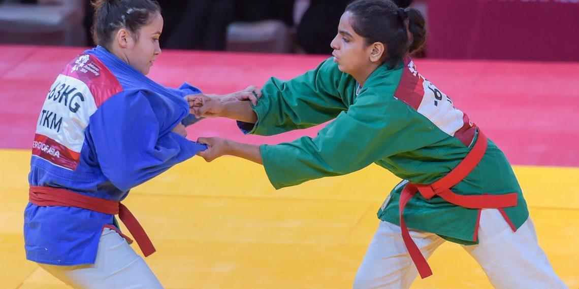 Megha Tokas (green) competes with Turkmenistan's Gulshat Nasyrova in women's 63kg Kurash at Jakarta