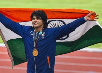 Gold medallist Neeraj Chopra poses for photographs at the medal ceremony of the men's javelin throw event of the Asian Games