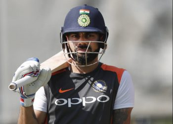 Virat Kohli waits for his chance at the nets during India's practice session