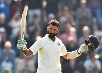 India's Cheteshwar Pujara celebrates his century against England at Southampton, Friday