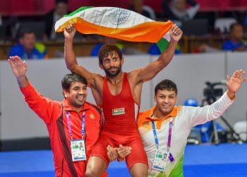 Bajrang Punia carries the tricolour after winning gold in men's freestyle wrestling (65kg) event at the Asian Games