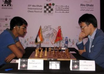 VS Rathanvel (L) plays against his Vietnam opponent