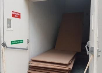 One of the emergency exits blocked by plywood