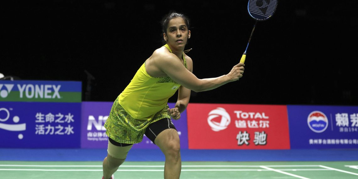 Saina Nehwal of India accidentally hits the shuttlecock out of play as she competes against Carolina Marin of Spain in their women's singles quarterfinal match at the Badminton World Championships in Nanjing, China, Friday