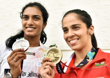 Indian shuttlers at Asian Games Silver medallist PV Sindhu and Bronze medallist Saina Nehwal pose for a photo after a press conference in Hyderabad