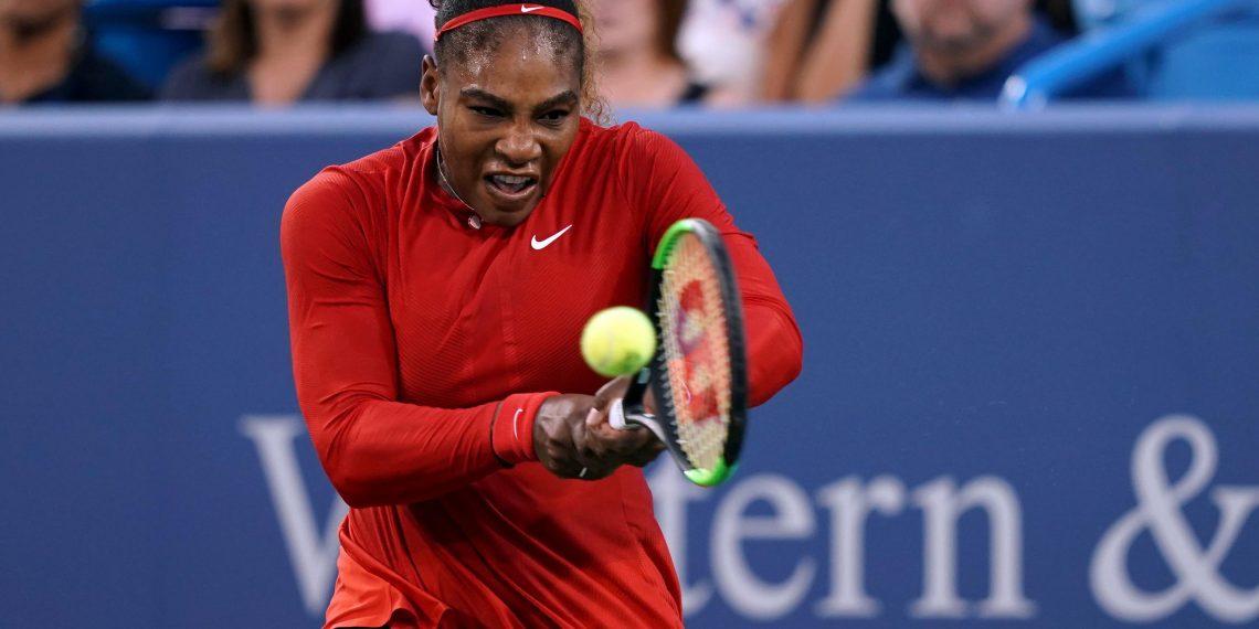 Serena Williams returns a shot against Daria Gavrilova in the Cincinnati Open tennis tournament