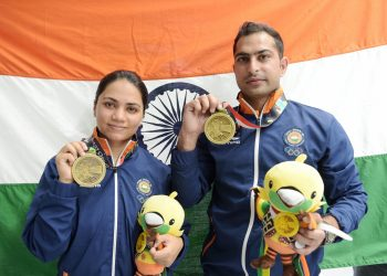 Apurvi Chandela and Ravi Kumar pose with their bronze medals at Palembang, Sunday
