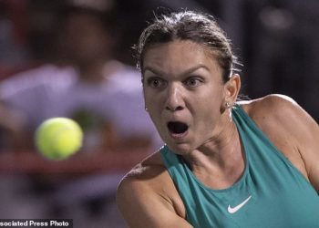 Caption  Hawk-eyed: Simona Halep of Romania watches the ball intently during her match against Venus Williams