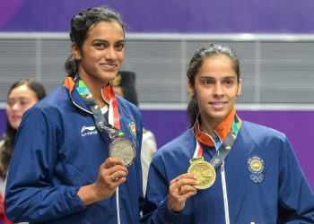 PV Sindhu (L) and Saina Nehwal pose with their badminton singles silver and bronze medals respectively