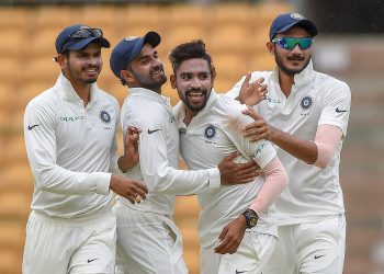 Mohammed Siraj (2nd from right) celebrates after dismissing a South Africa A wicket, Monday
