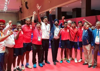 Table tennis Players and officials celebrate after India's historic bronze, Tuesday