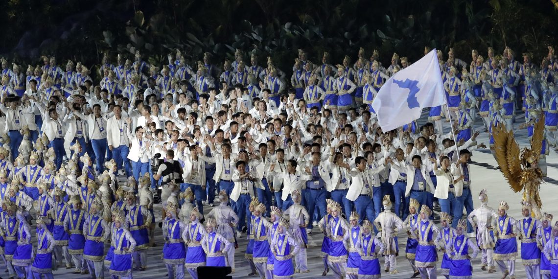 The combined Koreas march into Gelora Bung Karno Stadium under the 'unification' flag during the opening ceremony for the 18th Asian Games in Jakarta