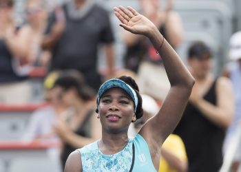 Venus Williams waves to the crowd following her win over Caroline Dolehide at Montreal, Monday