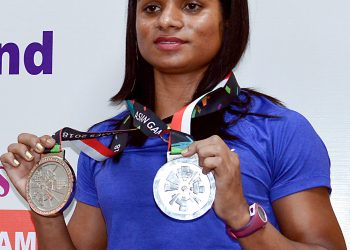 Asian Games winner Indian Athlete Dutee Chand displays her medals during an event, in Bangalore