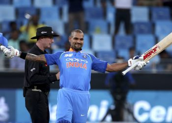 Shikhar Dhawan celebrates after scoring his 14th ODI century against Hong Kong in Dubai