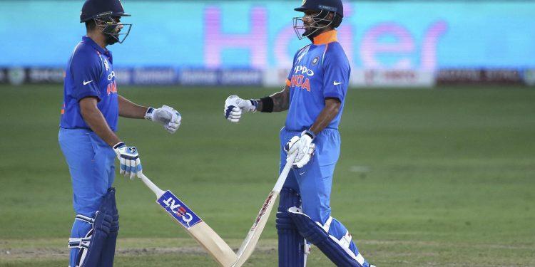 Rohit Sharma (L) and Shikhar Dhawan greet each other during their ODI against Pakistan in Dubai