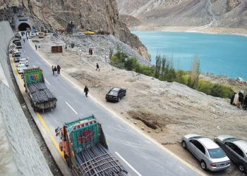 To go with story 'Pakistan-China-economy-transport, FEATURE' by Guillaume LAVALLÉE In this photograph taken on September 29, 2015, Pakistani commuters wait to travel through a newly built tunnel in northern Pakistan's Gojal Valley.  A glossy highway and hundreds of lorries transporting Chinese workers by the thousands: the new Silk Road is under construction in northern Pakistan, but locals living on the border are yet to be convinced they will receive more from it than dust.    AFP PHOTO / Aamir QURESHI