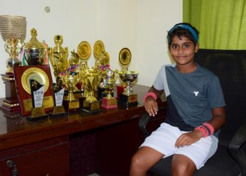 Sohini poses with the trophies she has won in the last 10 months