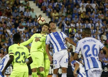 Barcelona's Gerard Pique (top left) duels for the ball against Leganes Mikel Vesga at Butarque stadium in Leganes, Spain, Wednesday