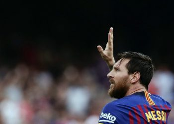 Barcelona's Lionel Messi celebrates scoring the opening goal against Huesca at the Camp Nou stadium